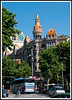 """Barcelona - View from Placa de Catalunya down Passeig de Gracia, one of the main shopping avenues in Barcelona. The building is an example of the """"Modernisme"""" or Catalan Art Nouveau and was the way of life as Barcelona burst into the 20th century."""