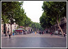 Barcelona - Ramblas looking toward Placa de Catalunya from near the harbor early in the morning as locals start off to work.