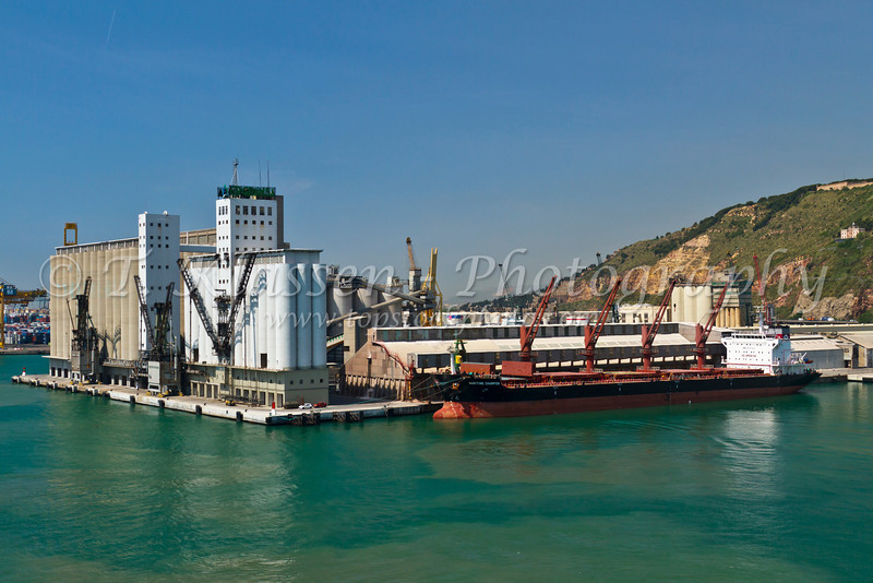 Cargo ships loading and unloading at the port of Barcelona, Spain.