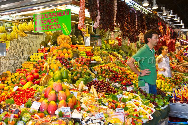 A large fruit market display in Barcelona, Spain.