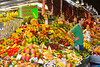 A large fruit market display in Barcelona, Spain.