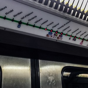 Inside-Barcelona-Metro-Train-Lighted-Sign-Above-Train-Doors