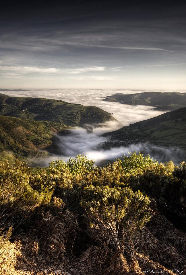 A river of clouds in a valley near O'Cebreiro on the Camino de Santiago in Spain.