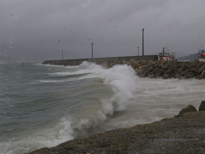 Waves from the Atlantic breaking during rain storm, south of Noia, Galicia, Spain