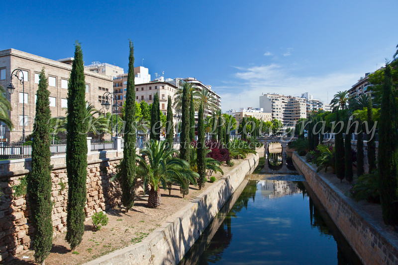 A park with tropical vegetation and a canal in Palma de Mallorca, Spain.