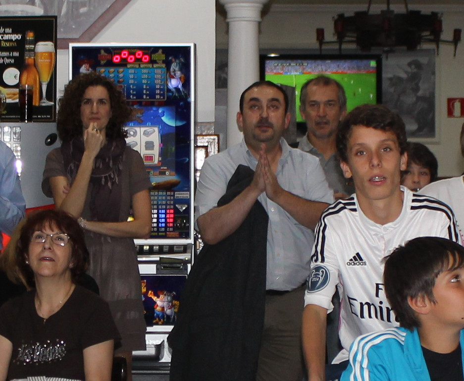 Fans Watch the Madrid-Barcelona Soccer Match