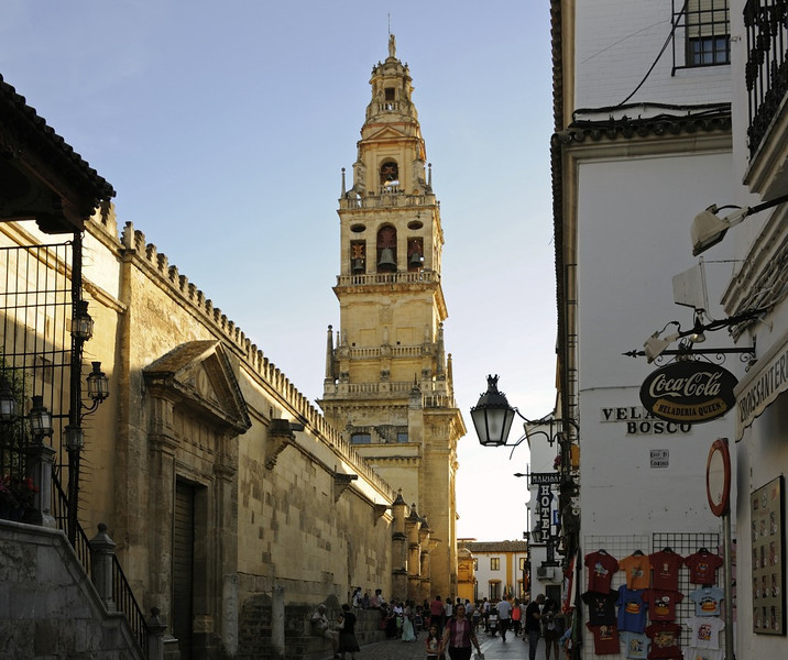 Bell tower and northern facade, Mezquita, Cordoba, Tues 6 May 2014.  Mezquita = mosque.  It was built and extended in the 8th - 10th centuries.  Moorish Cordoba fell in 1236, and the mosque was converted into a Catholic church.  The bell tower was built in the 17th century around the minaret.