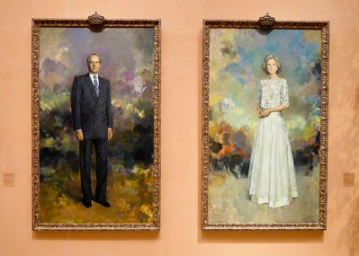 Portraits of King Juan Carlos and the Queen of Spain.
