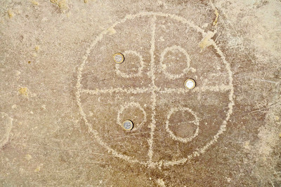 Italica near Seville - Ancient game carved into the forum's floor with Euro coins.