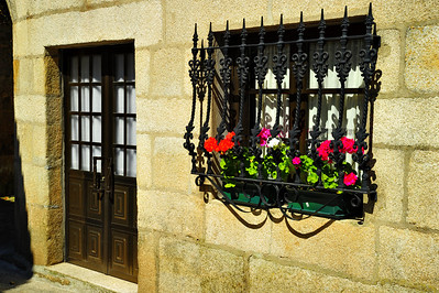 Door and flower dressed window Vigo, Spain
