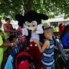 A crowd surrounds Mickey and Minnie Mouse as they arrive at the block party at New Life Spanish Christian Church in Fitchburg on Saturday afternoon. SENTINEL & ENTERPRISE / Ashley Green