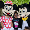 Keylanis Rosario, 9, snuggles up to Mickey and Minnie Mouse as they arrive at the block party at New Life Spanish Christian Church in Fitchburg on Saturday afternoon. SENTINEL & ENTERPRISE / Ashley Green