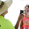 Gabriella Duarte, 5, gets her face painted during the block party at New Life Spanish Christian Church in Fitchburg on Saturday afternoon. SENTINEL & ENTERPRISE / Ashley Green