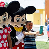 Alberto Muniz, 7, snaps a selfie with Mickey and Minnie Mouse as they arrive at the block party at New Life Spanish Christian Church in Fitchburg on Saturday afternoon. SENTINEL & ENTERPRISE / Ashley Green