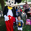 Zabdiel Berroa, 2, greets Mickey and Minnie Mouse as they arrive at the block party at New Life Spanish Christian Church in Fitchburg on Saturday afternoon. SENTINEL & ENTERPRISE / Ashley Green