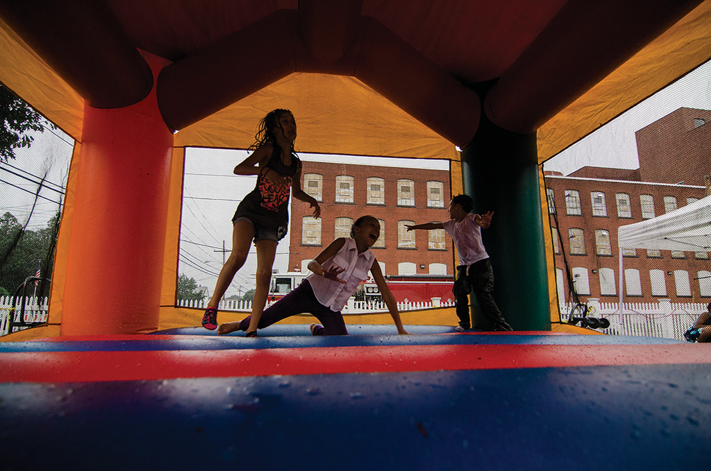 . Kids play in the bouncy house during the Spanish American Center\'s 50th anniversary block party on Saturday, August 5, 2017. SENTINEL & ENTERPRISE / Ashley Green