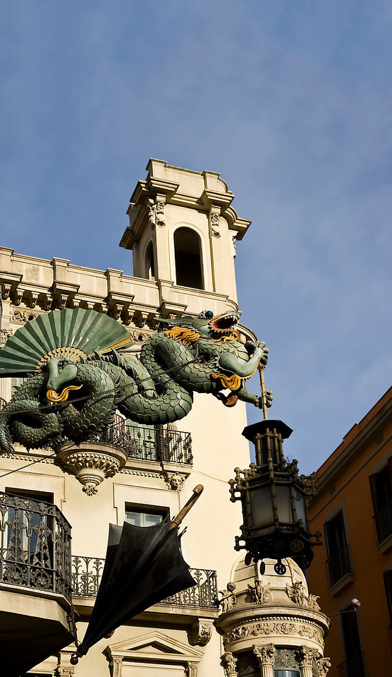 Green Dragon, Fan and Black Umbrella in Barcelona Spain