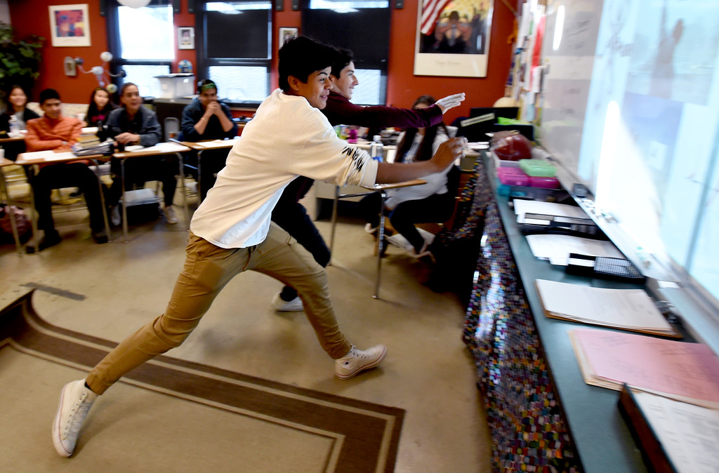 . Erick Colin Rios, left, and Edgar Lozano, , race to the screen during a teaching exercise. Peak to Peak Charter School has unveiled a new �Spanish for Heritage-Speakers� course this year that is providing 23 Spanish heritage speakers in grades 6-12 the ability to achieve full academic bi-literacy.  Cliff Grassmick  Photographer November 15, 2017