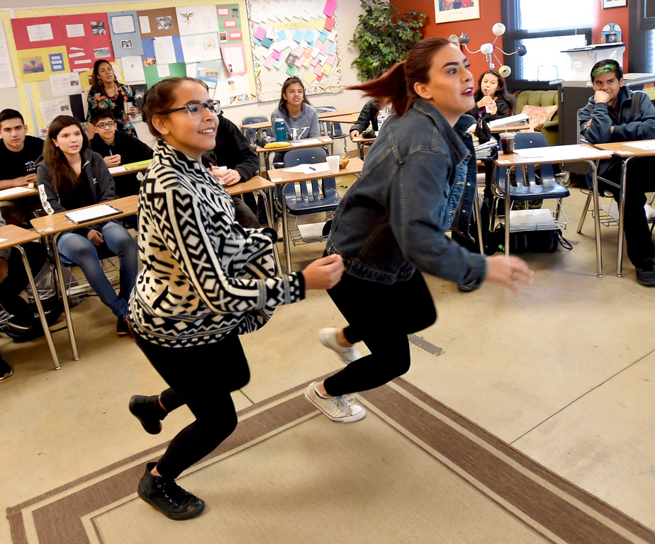 . Zoe Patricia Labansat Naver, left, and Ziranda Dominguez, race to the screen during a teaching exercise. Peak to Peak Charter School has unveiled a new �Spanish for Heritage-Speakers� course this year that is providing 23 Spanish heritage speakers in grades 6-12 the ability to achieve full academic bi-literacy.  Cliff Grassmick  Photographer November 15, 2017