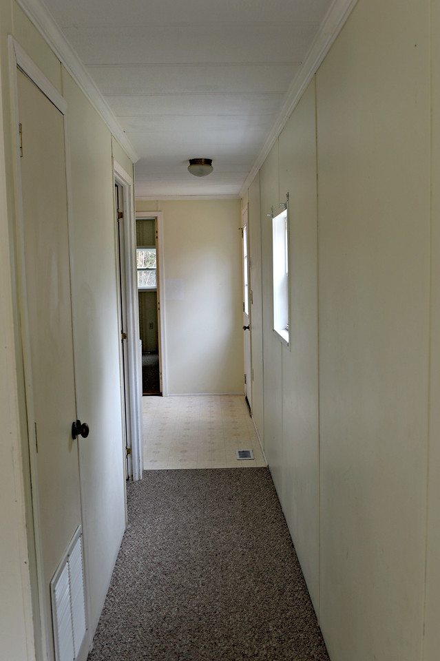 hallway to back 2 bedrooms and full bath