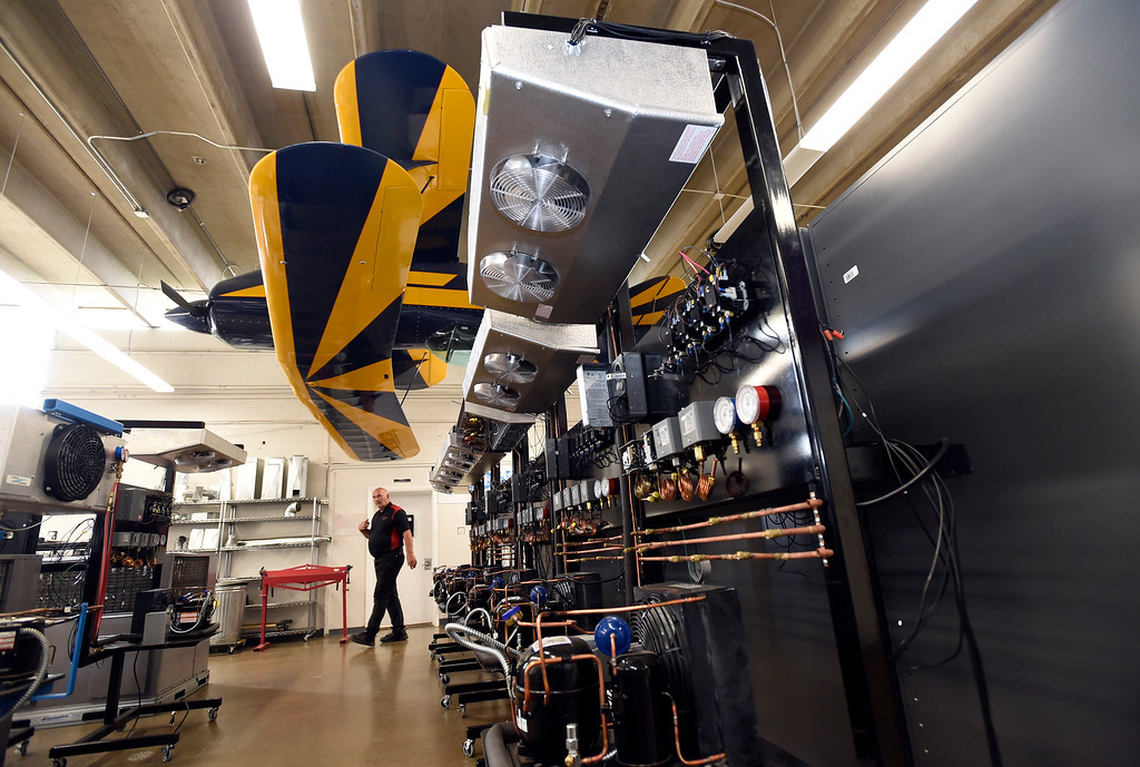 . Instructor Andy Langer walks past the basic refrigeration trainer for the HVAC program at the Spartan College of Aeronautics on Wednesday in Broomfield. For more photos of the course activity go to dailycamera.com Jeremy Papasso/ Staff Photographer 06/06/2018