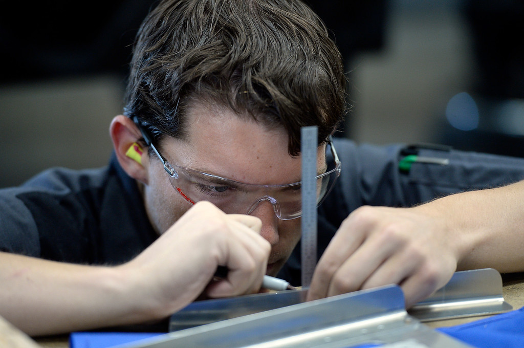 . Devin Emerson marks a piece of sheet metal while fabricating it to the proper specs at the Spartan College of Aeronautics on Wednesday in Broomfield. For more photos of the course activity go to dailycamera.com Jeremy Papasso/ Staff Photographer 06/06/2018