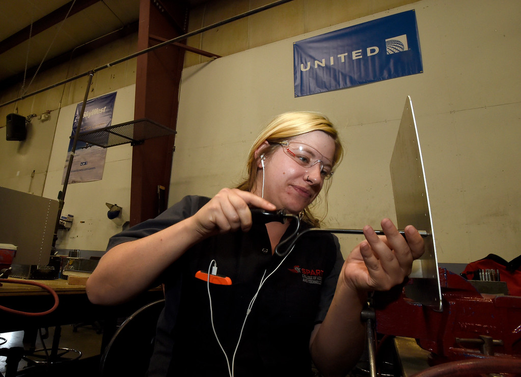 . Marlena Niforos works to deburr rivet holes during a class at the Spartan College of Aeronautics on Wednesday in Broomfield. For more photos of the course activity go to dailycamera.com Jeremy Papasso/ Staff Photographer 06/06/2018