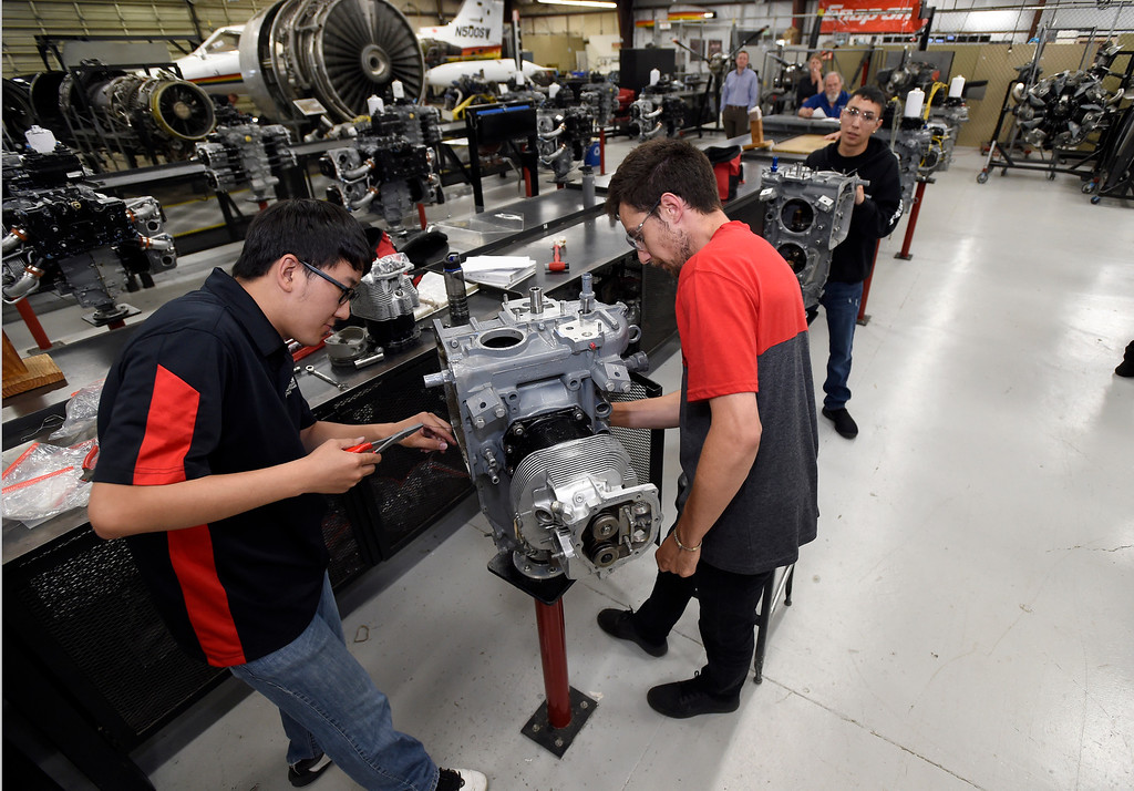 . Students Bumsoo Kim, left, Camron Ardalan and Julian Archuleta work to reassemble a reciprocating engine at the Spartan College of Aeronautics on Wednesday in Broomfield. For more photos of the course activity go to dailycamera.com Jeremy Papasso/ Staff Photographer 06/06/2018