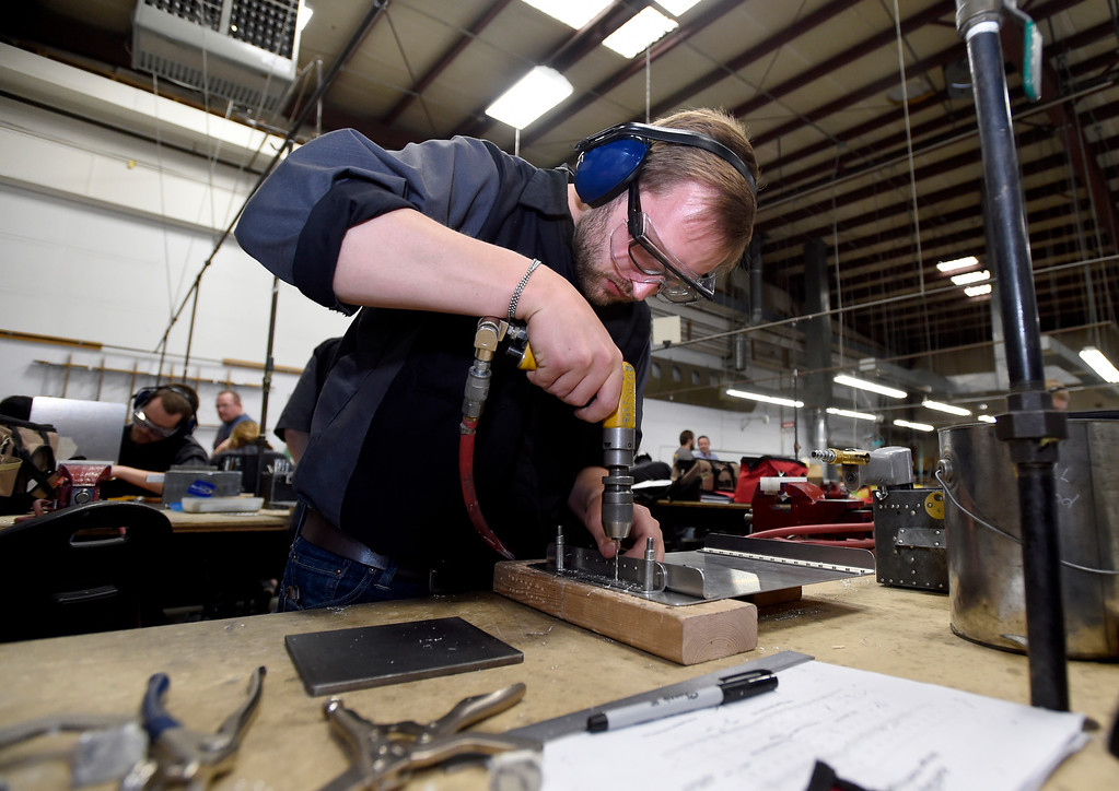 . Eric Froese drilles holes in a piece of sheet metal during class at the Spartan College of Aeronautics on Wednesday in Broomfield. For more photos of the course activity go to dailycamera.com Jeremy Papasso/ Staff Photographer 06/06/2018