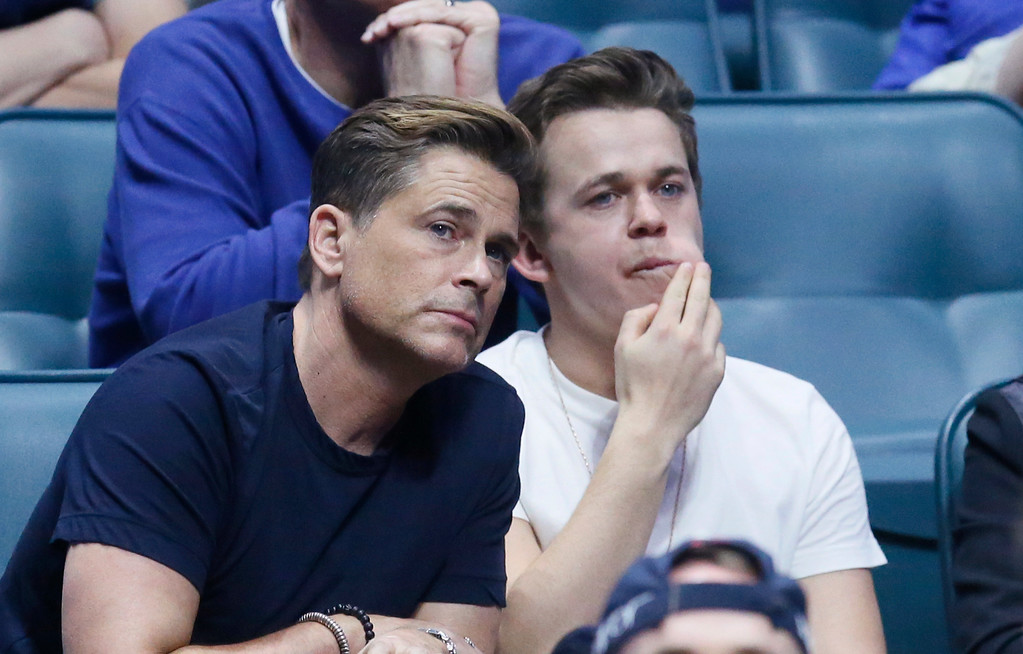 . Rob Lowe, left, watches a first-round game between Michigan State and Miami with his son, John Owen Lowe, right, in the men\'s NCAA college basketball tournament in Tulsa, Okla., Friday, March 17, 2017. (AP Photo/Sue Ogrocki)