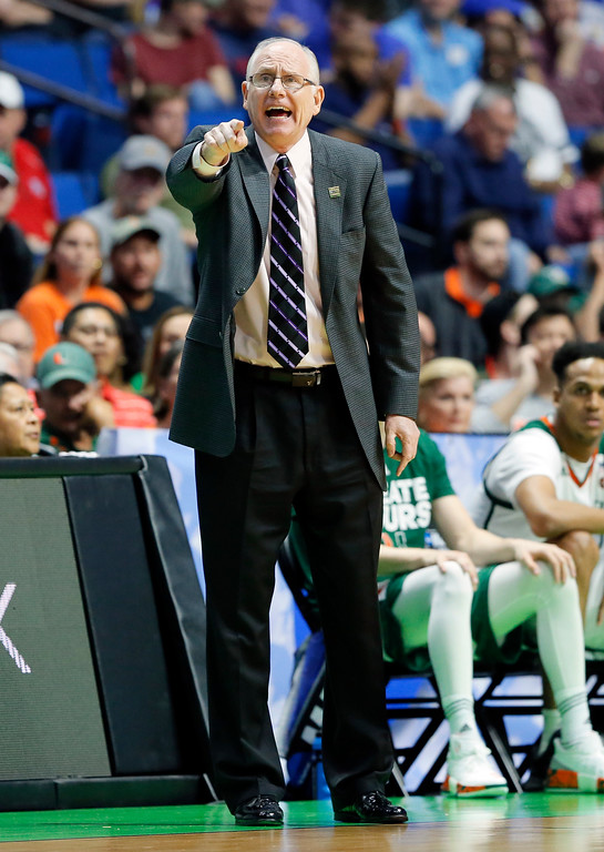. Miami head coach Jim Larranaga instructs his team in the first half of a first-round game in the men\'s NCAA college basketball tournament against Michigan State in Tulsa, Okla., Friday March 17, 2017. (AP Photo/Tony Gutierrez)