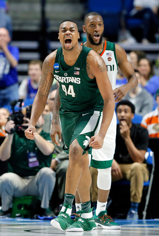 . Michigan State forward Nick Ward (44) celebrates sinking a basket in front of Miami forward Kamari Murphy, rear, in the first half of a first-round game in the men\'s NCAA college basketball tournament in Tulsa, Okla., Friday March 17, 2017. Ward led the game in scoring with 19 points in the 78-58 win over Miami. (AP Photo/Tony Gutierrez)