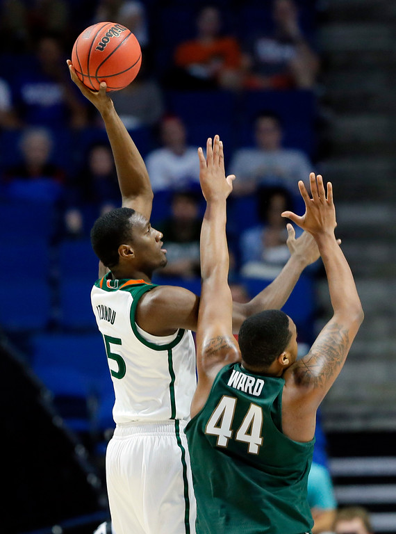 . Miami center Ebuka Izundu (15) attempts a shot over Michigan State\'s Nick Ward (44) in the second half of a first-round game in the men\'s NCAA college basketball tournament in Tulsa, Okla., Friday March 17, 2017. (AP Photo/Tony Gutierrez)