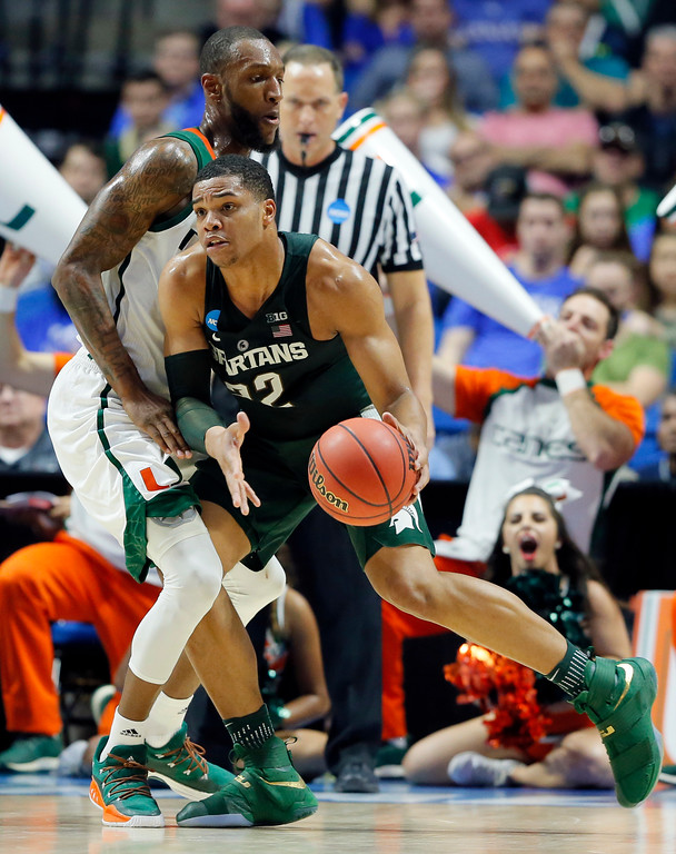 . Michigan State guard Miles Bridges (22) works for a shot against Miami forward Kamari Murphy, left, in the first half of a first-round game in the men\'s NCAA college basketball tournament in Tulsa, Okla., Friday March 17, 2017. (AP Photo/Tony Gutierrez)