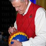 Coach Denny Crum autographed a basketball.