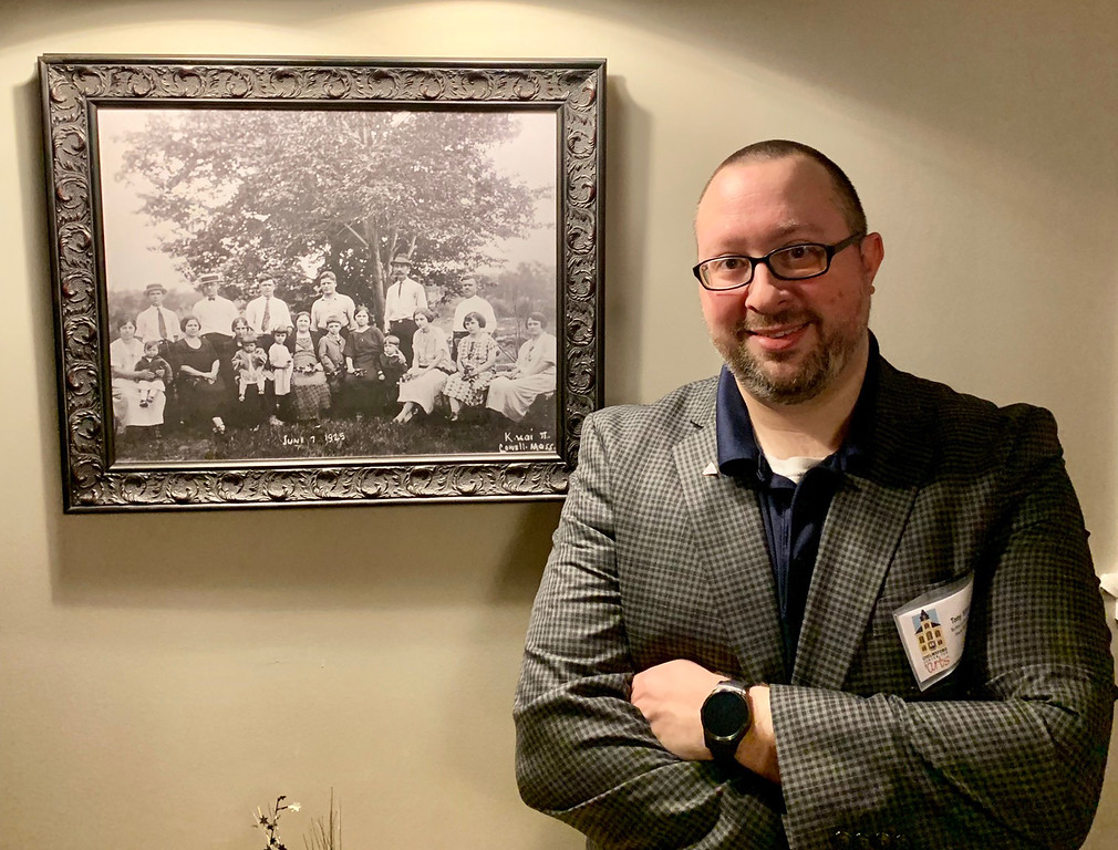 . CCA Technical Director and House Manager Tony Silvia of Chelmsford stands in front of a photo depicting the family of Dacey�s father, Sam Zouzas. The family settled on more than 70 acres of farmland in Chelmsford in 1925.