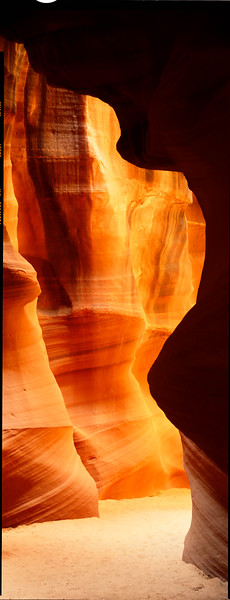 Upper Antelope Canyon, West of Page, Arizona.  By the time light gets down here it has bounced off the walls at least 3 times.
