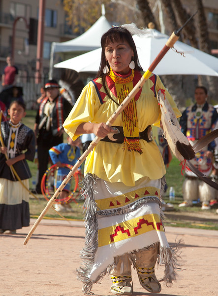 An Apache lady performing a dance the women do when their men go out for a battle.