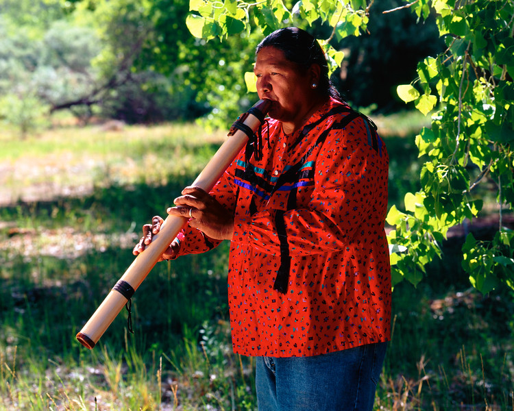 Travis Terry, Navajo flute player, giving an impromptu concert in Canyon de Chelly