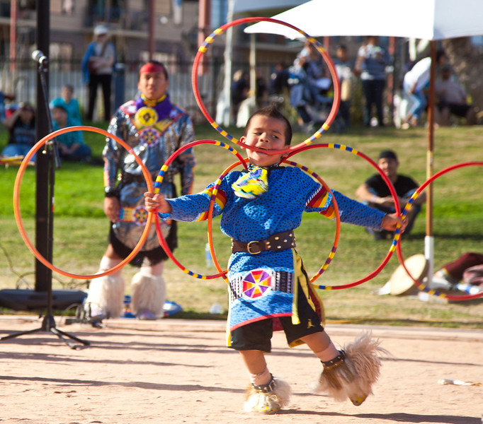 I believe this is the 5 year old son of Tony Duncan, 5 time world hoop dancing champion.  The proud father is in the background.  Taken at the 54th annual Heard Museum Indian Fair and Market, 3-4-2012.