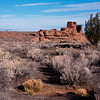 A distant photograph of the Wupatki ruins, looking like a lonely ship on a vast desert