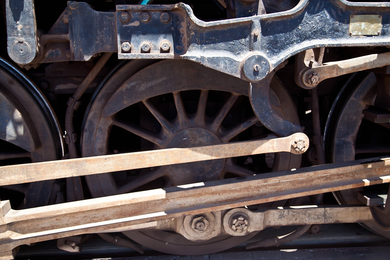 Detail of drive whells and rods on working steam engine 4960 of the Grand Canyon Railroad