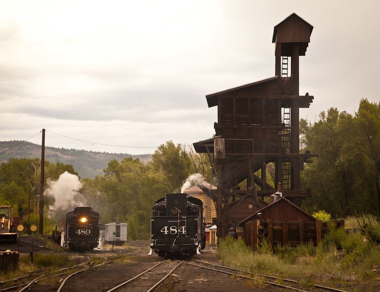 Engines of the Cumbres & Toltec taking on coal at the end of the day.  The famous coal tower on the right is no longer used because the front end loader off the right of the photo can do the same job more quickly and cleanly.