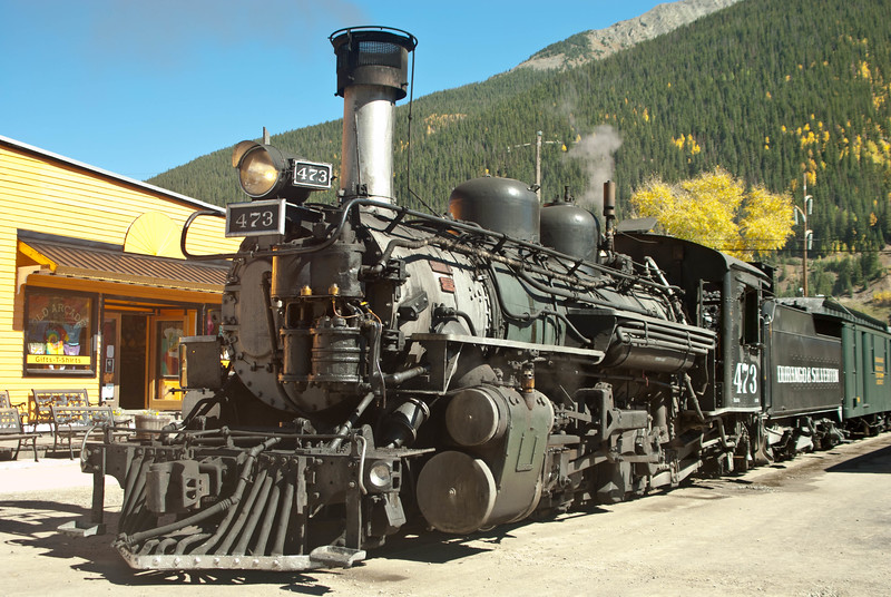 Durango & Silverton engine # 473 in Silverton, Colorado.  The trains stop right in front of the Old Arcade Gift Shop, so they have by far the best location in Silverton.