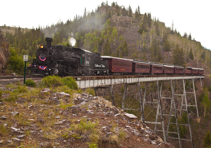 Cumbres & Toltec engine 484 travelling from Chama, NM to Antonito, CO, over the Cascade Trestle bridge, the highest railroad bridge in the country.  Visibility for the photo was reduced because a significant hailstorm just started, on July 4, 2014.