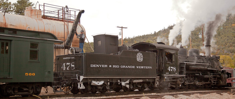 The Durango & Silverton Narrow Gauge Railway engine # 478 stopping to take on water just North of Durango, enroute to Silverton, Colorado.