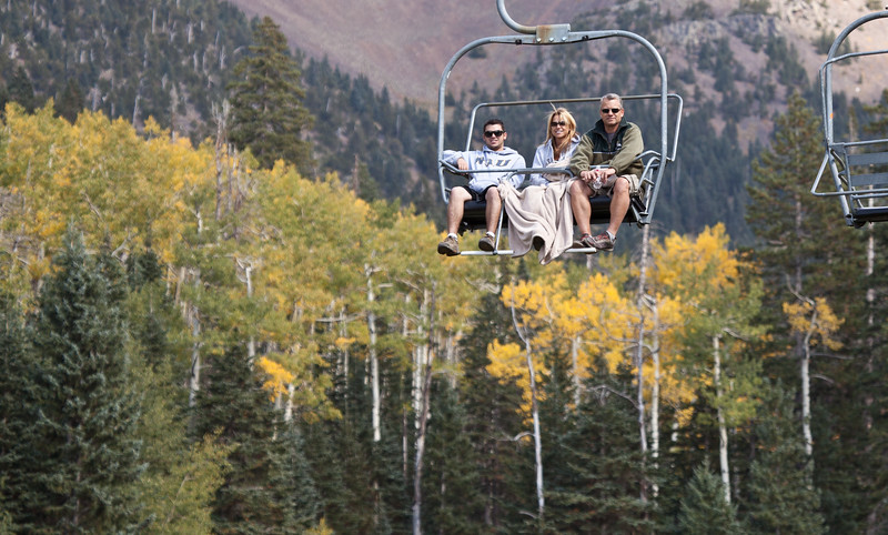 Having fun on the Chair lift at Snow Bowl ski area in Flagstaff, on Route 66.  There was snow on top of the peaks the morning this was taken in early October, 2012