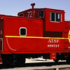 A refurbished caboose in the Williams train yard.  The caboose really was this bright color.  Trains are an important part of Route 66 since a major national mainline runs next to the highway.