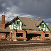 The Amtrac passenger station in Flagstaff, AZ, right on route 66, October, 2012.  The sun was coming in below the storm clouds building up.