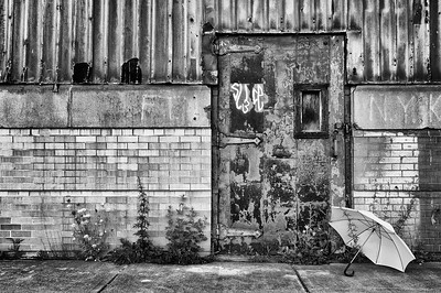 """Umbrella #1""  Boston, MA -This vacant building stands on the Boston waterfront. It was built in 1940 to help build ships but is now empty. #16 Warehouse in Boston's Back Bay. 365080212"